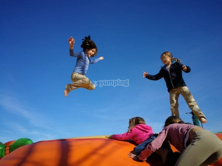 Children jumping on the inflatable