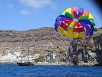 Whale watching and parasailing children in Mogán