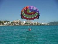 Parasailing raising the flight in Mallorca