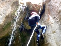 man going down a mountain with water
