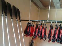 life jackets next to some oars