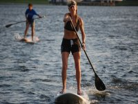 woman and a child practicing sup