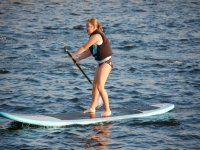 girl practicing sup in water