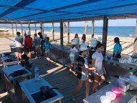 Clase de cocina en la playa