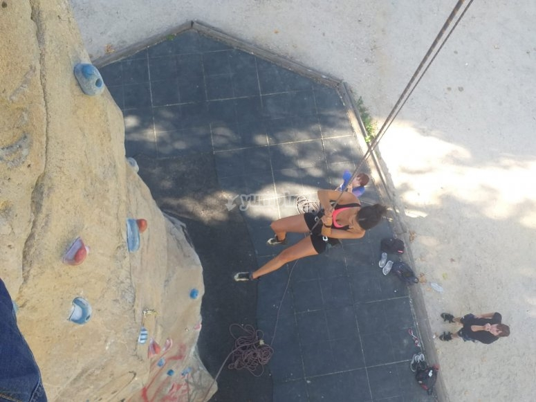 Climbing in an outdoor climbing wall