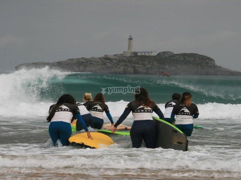 Group of girls surfing in Somo