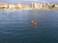 Paddling on the kayak in Gijón