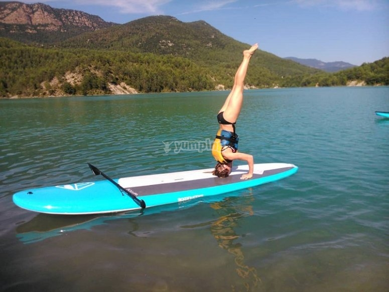Doing a handstand on the board