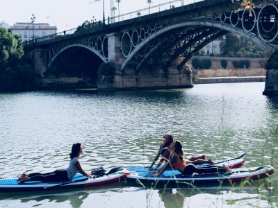 SUP yoga class on the Guadalquivir river Seville