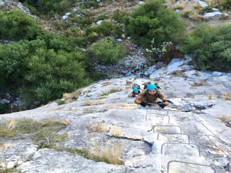 Climbing up the staples of the ferrata