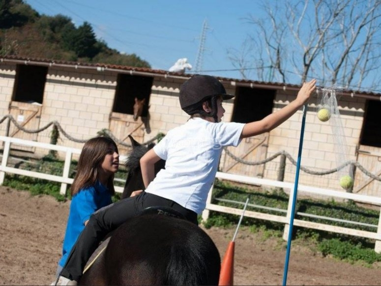 Horse riding and playing with balls