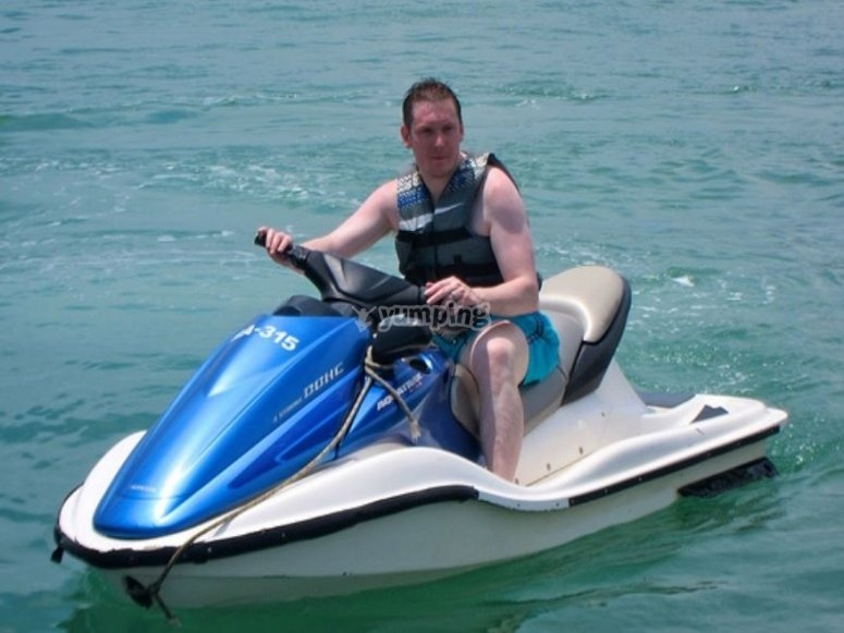 Holding the controls of the jet ski