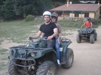In two-seater quads in the mountains