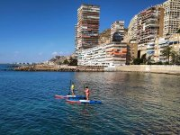 Doing paddle surf in the Alicante waters