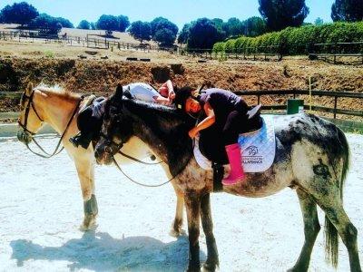 Paseo a caballo 2 adultos y 2 niños río Guadarrama