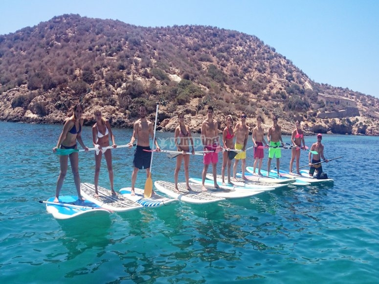 Friends with paddle surf boards