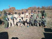 Paintball players equipped