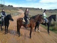 Three girls on horseback