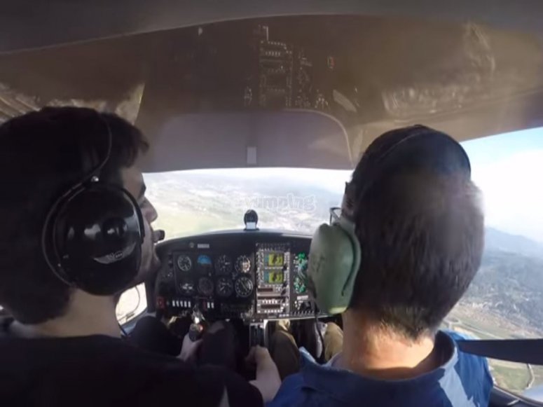 Along with the pilot in the cockpit of the plane