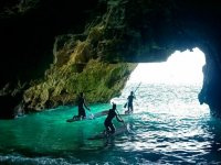 In the cave with the paddle surf boards