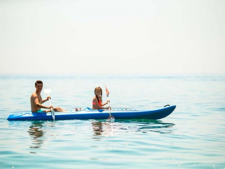 Father and daughter enjoying a kayak trip