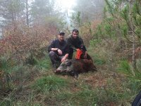 Posing with the wild boar