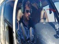 persona all'interno di un helicopter.jpg