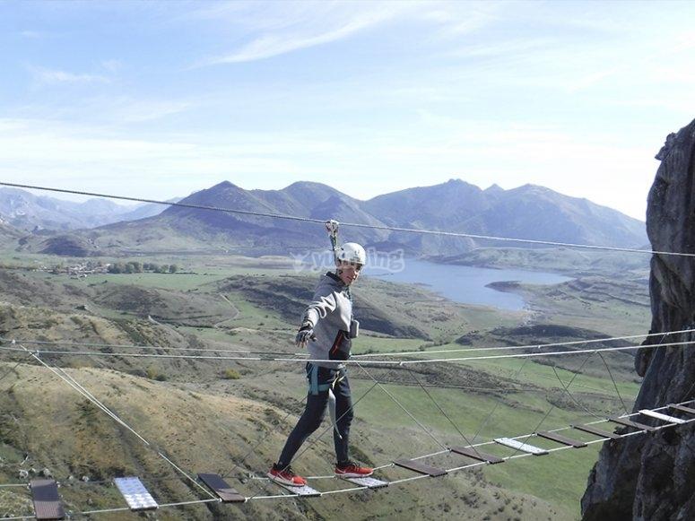 Overcoming the suspension bridge of the ferrata
