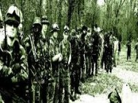group of friends lined up in an airsoft field.jpg