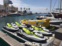 Jet skis next to the boats
