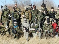 group of friends in an airsoft field