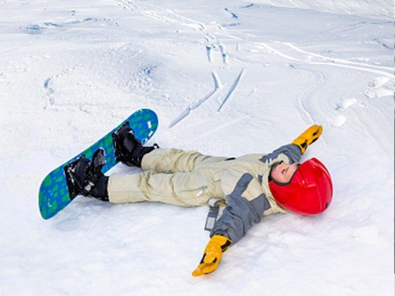 Enjoying the snow by snowboarding
