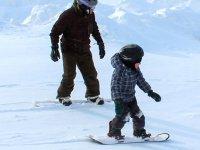 Having fun in their children's snowboard class