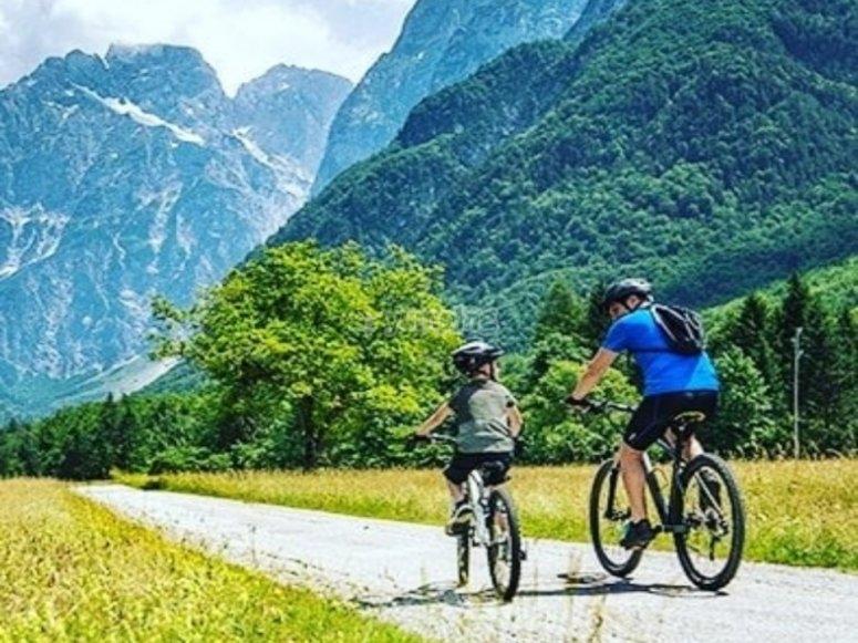 Father and son enjoying their mountain bike through the Pyrenees