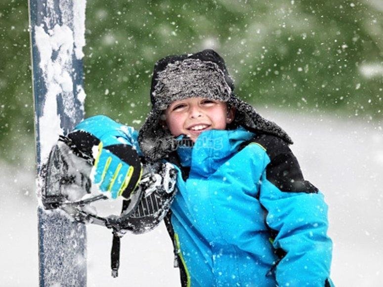 Child in snowboarding classes
