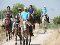 Horseback riding along the path
