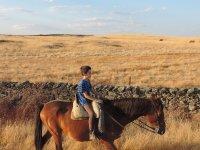 Children riding on horseback