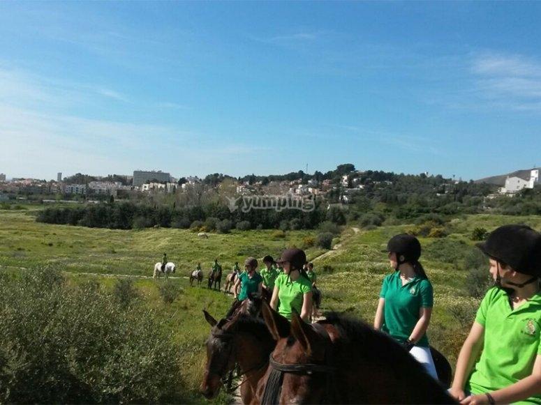 Horseback riding with friends through Torremolinos