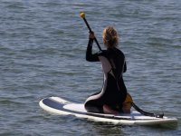 On the paddle surfboard