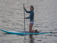 Woman practicing paddle surfing