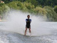 Being dragged to water ski