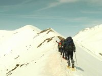 Climbing the mountain with snowshoes