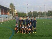 Niños jugadores de fútbol