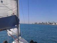 Sailboat towards the coast