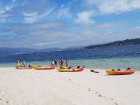 Kayaks on the sunny beach of Pontevedra