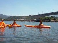 Individual kayaks next to the bridge