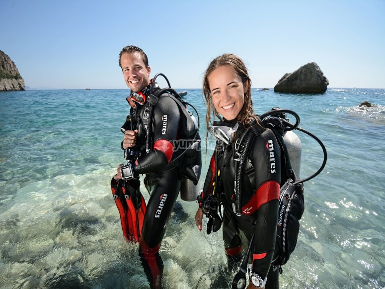 With the diving equipment on the shore