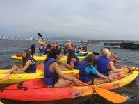 Girls sharing kayak in Pontevedra