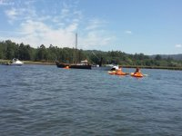 Kayaks approaching the boats