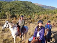 Horseback riding through valley